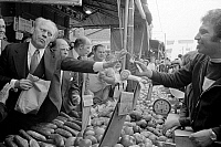 0125907 © Granger - Historical Picture ArchiveGERALD FORD (1913-2006).   38th President of the United States. Ford (left) visiting a farmers' market in Philadelphia, Pennsylvania, while campaigning for president, September 1976. Photographed by Marion S. Trikosko.