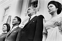 0126406 © Granger - Historical Picture ArchiveJOHNSON AND MARCOS, 1966.   U.S. President Lyndon Johnson (center) with President Ferdinand Marcos of the Philippines and their wives, Lady Bird Johnson (left) and Imelda Marcos, at the White House in Washington, D.C., 14 September 1966. Photographed by Marion S. Trikosko.