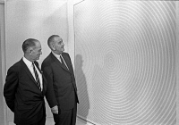0527715 © Granger - Historical Picture ArchiveWHITE HOUSE ART FESTIVAL.   Senator J. William Fulbright and President Lyndon B. Johnson looking at 'Squaring the Circle' by Richard Anuszkiewicz at the White House Art Festival. Photograph by Yoichi Okamoto, 14 June 1965.
