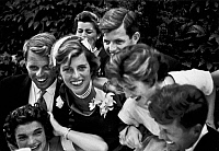 0116070 © Granger - Historical Picture ArchiveKENNEDY WEDDING, 1953.   The Kennedy family surrounding John (lower right) and Jacqueline (lower left) on their wedding day, 12 September 1953. Photograph by Toni Frissell.