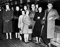 0168681 © Granger - Historical Picture ArchiveKENNEDY FAMILY, 1938.   American businessman and diplomat Joseph P. Kennedy, Sr., photographed with eight of his nine children in New York City prior to his departure to begin serving as U.S. Amabassador to Great Britian, 23 February 1938. Left to right: Patricia, Kathleen, Eunice, Robert, Jean, Joseph Sr., Edward, Rosemary, Joseph Jr.