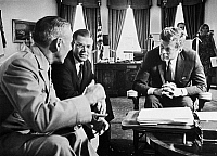 0176763 © Granger - Historical Picture ArchiveJOHN F. KENNEDY (1917-1963).   35th President of the United States. Being briefed on the situation in South Vietnam by General Maxwell Taylor, Chairman of the Joint Chiefs of Staff (left), and Robert McNamara, Secretary of Defense (center), in the Oval Office of the White House, Washington, D.C., 2 October 1963.