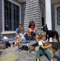 0527152 © Granger - Historical Picture ArchiveKENNEDY FAMILY, 1963.   John and Jacqueline Kennedy, with their children, John Jr. and Caroline, and their dogs, Shannon, White Tips, Blackie, Clipper, Charlie, and Wolf, on vacation in Hyannis Port, Massachusetts. Photograph by Cecil Stoughton, 14 August 1963.
