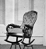 0032051 © Granger - Historical Picture ArchiveLINCOLN'S ROCKING CHAIR.   The rocking chair used by President Abraham Lincoln in his box at the Ford's Theatre. Photographed in 1865.