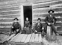 0124581 © Granger - Historical Picture ArchiveLINCOLN CABIN, c1891.   A group of four people including Mr. Thomas Lincoln's great grandson, John J. Hall in front of a log cabin that was built by Thomas Lincoln and visited by his son, Abraham Lincoln in in Macon County, Illinois. Photograph by W.J. Root, c1891.