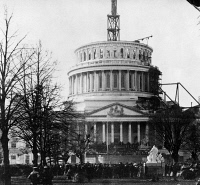 0622397 © Granger - Historical Picture ArchiveLINCOLN INAUGURATION, 1861.   Crowd assembled before the United States Capitol for the first inauguration of President Abraham Lincoln; note the Capitol Dome, still under construction. Photograph, 4 March 1861.