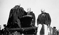 0033050 © Granger - Historical Picture ArchiveMcKINLEY TAKING OATH, 1897.   Chief Justice Melville W. Fuller administering the Presidential oath of office to William McKinley, 4 March 1897. To the right is the outgoing President, Grover Cleveland.