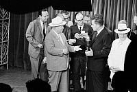 0126398 © Granger - Historical Picture ArchiveNIXON AND KHRUSHCHEV, 1959.   U.S. Vice President Richard Nixon (right, at microphone) debating Soviet Premier Nikita Khrushchev on the respective merits of capitalism and communism in the television studio of the American National Exhibition in Moscow, part of their so-called 'kitchen debate,' 24 July 1959. Photographed by Thomas J. O'Halloran.