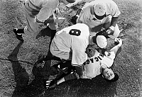 0131693 © Granger - Historical Picture ArchiveRONALD REAGAN (1911-2004).   40th President of the United States. Reagan, on the ground, as the retired baseball pitcher Grover Cleveland Alexander in the film 'The Winning Team,' 1952.