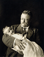 0120533 © Granger - Historical Picture ArchiveTHEODORE ROOSEVELT   (1858-1919). 26th President of the United States, holding his grandson, Kermit Roosevelt, Jr., 1916.