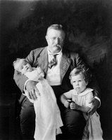 0120535 © Granger - Historical Picture ArchiveTHEODORE ROOSEVELT   (1858-1919). 26th President of the United States, with his two grandsons Kermit Roosevelt, Jr. (infant) and Richard Derby. Photograph by Walter Scott Shinn, c1916.