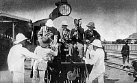 0124071 © Granger - Historical Picture ArchiveTHEODORE ROOSEVELT   (1858-1919). 26th President of the United States. Roosevelt (seated, second from left) riding with two friends and a guide at the front of a locomotive from Mombasa to Nairobi, Kenya, during his expedition to Africa in 1909.