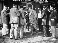 0621827 © Granger - Historical Picture ArchiveTHEODORE ROOSEVELT  (1858-1919). 26th President of the United States. Conversing with reporters at his home, Sagamore Hill, near Oyster Bay, New York. Photograph, 3 June 1912.