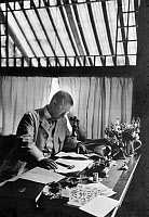 0621833 © Granger - Historical Picture ArchiveTHEODORE ROOSEVELT  (1858-1919). 26th President of the United States. Seated at his desk in his home, Sagamore Hill, near Oyster Bay, New York. Photograph, 11 September 1905.