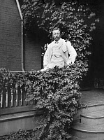 0621834 © Granger - Historical Picture ArchiveTHEODORE ROOSEVELT  (1858-1919). 26th President of the United States. Seated on a veranda railing at his home, Sagamore Hill, near Oyster Bay, New York. Photograph, 11 September 1905.