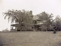0621836 © Granger - Historical Picture ArchiveSAGAMORE HILL, 1905.   President Theodore Roosevelt's home, Sagamore Hill, near Oyster Bay, New York, viewed through trees. Photograph, 14 September 1905.