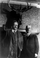 0623232 © Granger - Historical Picture ArchiveTHEODORE ROOSEVELT   (1858-1919). 26th President of the United States. Roosevelt and professor John Paul Gooode posed under a mounted moose head above Goode's fireplace, during the Bull Moose Campaign. Photograph, 1912.