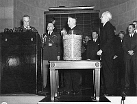 0005921 © Granger - Historical Picture ArchiveFRANKLIN D. ROOSEVELT.   The first peacetime compulsory military service in the United States begins as President F.D. Roosevelt (left) reads Number 158, the first draft serial number picked by Sec. of War Henry L. Stimson (center) from a bowl in the War Department auditorium in Washington, D.C., on Oct. 29, 1940.