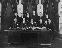 0014178 © Granger - Historical Picture ArchiveFRANKLIN DELANO ROOSEVELT   (1882-1945). 32nd President of the United States. Roosevelt (center, seated) and his first cabinet, 1933. Frances Perkins, Secretary of Labor, standing at extreme right.
