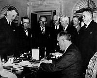 0108589 © Granger - Historical Picture ArchiveFRANKLIN D. ROOSEVELT  (1882-1945). 32nd President of the United States. Roosevelt signing the repeal of the arms embargo, 4 November 1939. From left: Senator Key Pittman, Representative Sol Bloom, Speaker of the House William Bankhead, Secretary of State Cordell Hull, Vice President John Nance Garner, Senator Charles McNary, and Senator Alben Barkley.