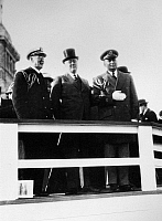 0131582 © Granger - Historical Picture ArchiveFRANKLIN D. ROOSEVELT   (1882-1945). 32nd President of the United States. President Roosevelt, center, with aides, at the celebration of the 50th anniversary of the Statue of Liberty in New York Harbor, 28 October 1936.