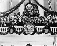 0174681 © Granger - Historical Picture ArchiveROOSEVELT INAUGURATION.   Chief Justice Charles Evans Hughes administers the oath of office to president Franklin D. Roosevelt on the east portico of the U.S. Capitol in Washington, D.C. Photograph, 4 March 1933.