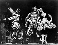 0128690 © Granger - Historical Picture ArchiveBALLET: PETROUCHKA.   Left to right: Ted Kivitt, Bruce Marks, and Eleanor D'Antuono performing in an American Ballet Theatre production of 'Petrouchka,' with choreography by Michel Fokine and music by Igor Stravinsky, c1970.