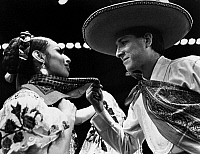 0172605 © Granger - Historical Picture ArchiveMEXICAN FOLK DANCERS, c1965.   Azucena Jimenez and Humberto Trevino of Ballet Folklorico de Mexico, perform a handkerchief courting dance from the folk ballet, 'Chiapas,' c1965.