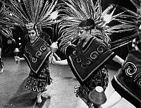 0172614 © Granger - Historical Picture ArchiveMEXICAN FOLK DANCE, c1970.   Mexican dancers performing with traditional rattles and wearing the costumes of Aztec priestesses, in 'Los Concheros (The Shell Dancers), by the Ballet Folklorico de Mexico de Amalia Hernandez, c1970.
