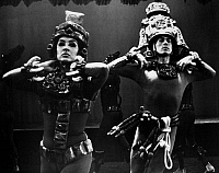 0172619 © Granger - Historical Picture ArchiveMEXICAN FOLK DANCE, c1970.   Dancers dressed as Aztecs in a scene by the Ballet Folklorico de Mexico de Amalia Hernandez, c1970.