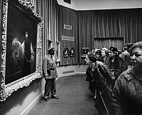 0174758 © Granger - Historical Picture ArchivePARKE-BERNET GALLERIES, c1960.   Visitors at the Parke-Bernet Galleries in New York examining Rembrandt's 'Aristotle Contemplating the Bust of Homer.' Photograph, c1960.