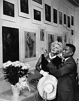 0174761 © Granger - Historical Picture ArchiveART GALLERY, 1962.   Ilona Massey and an unidentified man viewing artwork in a gallery. Photograph by Arnold Taylor, 1962.