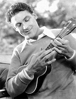 0034668 © Granger - Historical Picture ArchiveUKULELE PLAYER, c1927.   Cinemactor Charles Farrell playing the ukulele in a scene from an unidentified film.