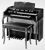0097039 © Granger - Historical Picture ArchiveHAMMOND ORGAN, 1960s.   The Hammond L-133 electric organ, in cherry. Photograph, American, 1960s.
