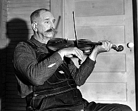 0122457 © Granger - Historical Picture ArchiveVIRGINIA: FIDDLER, 1934.   Davy Crockett Ward, a fiddler with the Bog Trotters Band, photographed by Alan Lomax in Galax, Virginia, 1934.