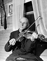 0122460 © Granger - Historical Picture ArchiveVIRGINIA: FIDDLER, 1937.   Alex Dunford, a fiddler with the Bog Trotters Band, photographed by Alan Lomax in Galax, Virginia, 1937.