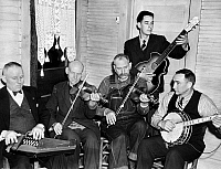 0122461 © Granger - Historical Picture ArchiveBOG TROTTERS BAND, 1937.   Members of the Bog Trotters Band. Left to right: Doc Davis with autoharp, Alex Dunford with fiddle, Crockett Ward with fiddle, Fields Ward with guitar, and Wade Ward with banjo. Photographed in Galax, Virginia by Alan Lomax, 1937.
