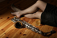 0376224 © Granger - Historical Picture ArchiveMUSICAL INSTRUMENT.     Alto saxophone on the floor next to a woman's leg. Full credit: Chris Stock / Lebrecht Music & Arts / Granger, NYC -- All rights reserved.