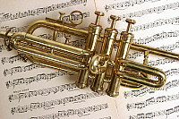 0379066 © Granger - Historical Picture ArchiveMUSICAL INSTRUMENT.    Fanfare trumpet, or ceremonial trumpet, close-up of the main body of the instrument, resting on sheet music. Also known as Aida trumpet. Full credit: Chris Stock / Lebrecht Music & Arts / Granger, NYC -- All rights re