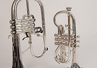0396358 © Granger - Historical Picture ArchiveMUSICAL INSTRUMENT.   Soprano cornet and a flugelhorn, detail of pistons. Brass band instruments, silver band instruments. Full credit: Chris Stock / Lebrecht Music & Arts / Granger, NYC -- All Rights Reserved.
