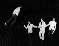 0169820 © Granger - Historical Picture ArchiveTHE BEATLES, 1964.   The Beatles 'fly' above the stage during a rehearsal for the 'Night of 100 Stars' charity show at the London Palladium, 1964. Left to right: Ringo Starr, Paul McCartney, John Lennon and George Harrison.