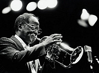 0374843 © Granger - Historical Picture ArchiveJAZZ MUSIC.    Clark Terry playing flugelhorn, 1992. American jazz trumpeter, flugelhorn player and singer. b.1920. Spotlight. Full credit: JazzSign / Lebrecht Music & Arts / Granger, NYC -- All Rights Reserved.