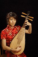 0396660 © Granger - Historical Picture ArchiveMUSICIAN AND INSTRUMENT.    Chinese girl playing a Chinese pipa, a traditional short-necked lute with a shallow piriform body, wooden sounding board, frets and four strings. Full credit: Chris Stock / Lebrecht Music & Arts / Granger, NYC -- All Rights Reserved.