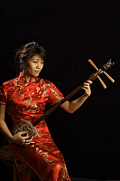 0396662 © Granger - Historical Picture ArchiveMUSICIAN AND INSTRUMENT.    Chinese girl playing a Chinese pipa, a traditional short-necked lute with a shallow piriform body, wooden sounding board, frets and four strings. Full credit: Chris Stock / Lebrecht Music & Arts / Granger, NYC -- All Rights Reserved.