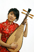 0396667 © Granger - Historical Picture ArchiveMUSICIAN AND INSTRUMENT.    Chinese girl playing a Chinese pipa, a traditional short-necked lute with a shallow piriform body, wooden sounding board, frets and four strings. Full credit: Chris Stock / Lebrecht Music & Arts / Granger, NYC -- All Rights Reserved.