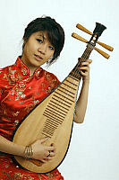 0396669 © Granger - Historical Picture ArchiveMUSICIAN AND INSTRUMENT.    Chinese girl playing a Chinese pipa, a traditional short-necked lute with a shallow piriform body, wooden sounding board, frets and four strings. Full credit: Chris Stock / Lebrecht Music & Arts / Granger, NYC -- All Rights Reserved.