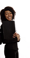 0396946 © Granger - Historical Picture ArchiveMUSICIAN AND INSTRUMENT.    Smiling choir girl holding her choir folder. Full credit: Chris Stock / Lebrecht Music & Arts / Granger, NYC -- All rights reserved.