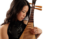 0397168 © Granger - Historical Picture ArchiveMUSICIAN AND INSTRUMENT.    Woman playing the pipa, or short-necked Chinese lute. Full credit: Chris Stock / Lebrecht Music & Arts / Granger, NYC -- All rights reserved.
