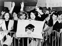 0526876 © Granger - Historical Picture ArchiveTHE BEATLES, 1964.   Screaming fans greeting the Beatles upon their arrival at John F. Kennedy Airport in New York City. Photograph, February 1964.