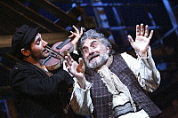 0382279 © Granger - Historical Picture ArchiveTHEATER PERFORMANCE.    'Fiddler On The Roof' - performance of the musical at the Savoy Theatre, London, UK, May 2007. Shown: Adrien Mastrosimone as The Fiddler and Henry Goodman as Tevye. Music by Jerry Bock. Lyrics by Sheldon Harnick. Book by Joseph Stein. Full credit: Tristram Kenton / Lebrecht Music & Arts / Granger, NYC -- All rights reserved.
